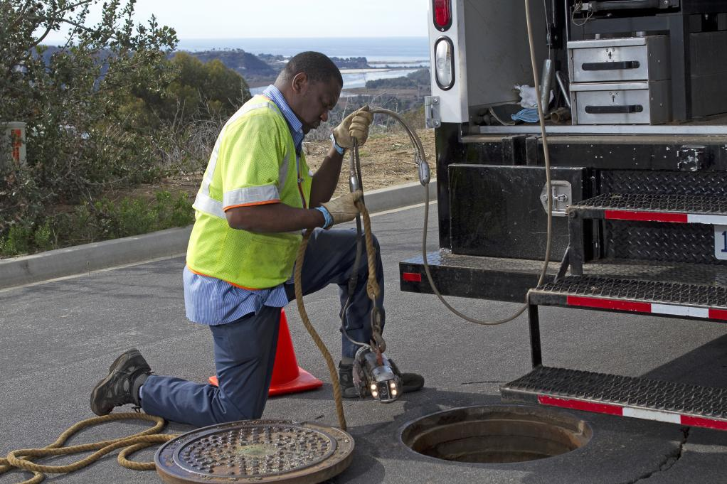 Crew member working on one of District's collection system 5,000 manholes