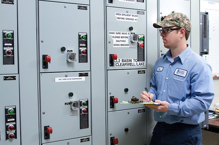 Field service department member inspects equipment.